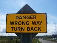 Yellow-Road-Sign-Saying-Danger-Wrong-Way-Turn-Back
